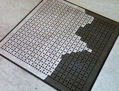 Perforated raised floor panel with surface coming off